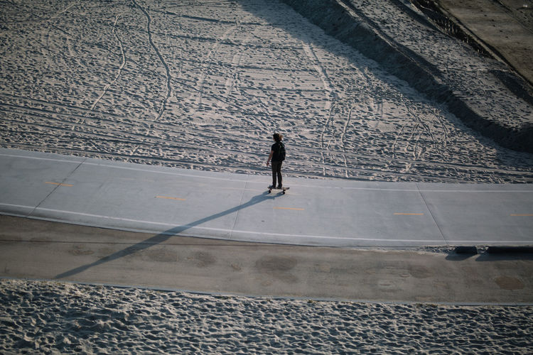 High angle view of man skateboarding on street