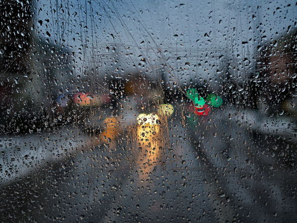 Rainy day road view with colorful lights from tram window Drop Wet Glass - Material Rain Window Water Transparent Transportation Mode Of Transportation Car Motor Vehicle Nature No People City RainDrop Rainy Season Indoors  Monsoon Torrential Rain Colorful Life Depressive Depression - Sadness Winter Cold Temperature