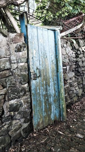 Ruin 12252720 Desolate Scene Derelict Leek No People Built Structure Cobblestones Outdoors Stone Wall Door Blue