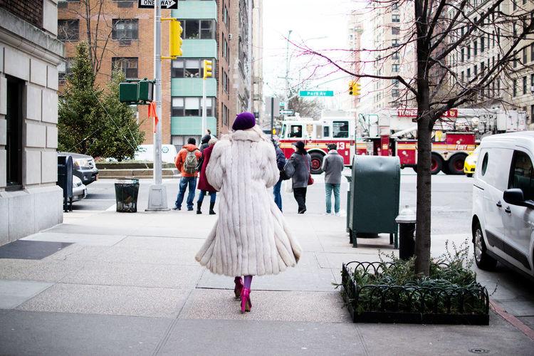 Fur clad woman walking toward Park Avenue in New York. City Life Fur Coat New York Park Avenue Real People Upper East Side Manhattan  Walking Winter Fashion Women