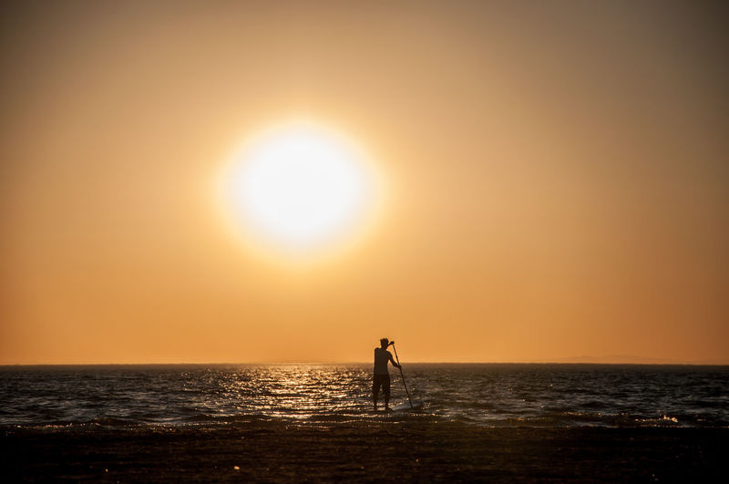 Alone Time Beach Beauty In Nature Epic Funsport Horizon Over Water Idyllic Majestic Men Nature Paddlesurf Remote Scenics Sea Silhouette Silhouette Stand Up Paddling Standing Sun Sundowner Sunset Sup Tranquil Scene Tranquility Water
