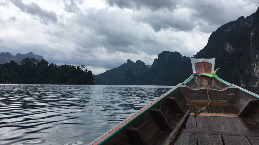 Cropped image of longtail boat in lake