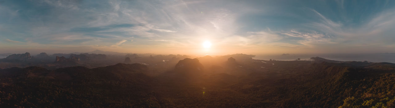 Sunrise over Krabi. Panorama drone shot from an early morning hike up the Hang Nak Peak, Mu Ko Phi Phi National Park, Krabi, Thailand. Sky Cloud - Sky Scenics - Nature Beauty In Nature Sun Sunbeam Mountain Panoramic Sunlight Landscape Lens Flare No People Idyllic Bright Outdoors Morning Krabi Thailand Hiking Adventures Drone  DJI Mavic Air Early Morning Discover Places Travel Destinations Hiking