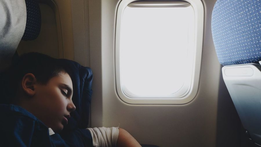 Child Sleeping In The Airplane