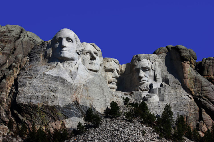Mount Rushmore Mount Rushmore President Rushmore South Dakota Art And Craft Clear Sky Creativity Day Human Representation Low Angle View Male Likeness Nature No People Outdoors Sculpture Sky Statue
