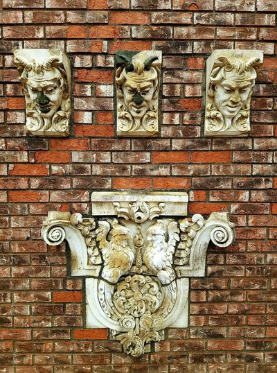 The color is so bold and interesting. Gargoyles and Mementos from the old Pennsylvania Railroad station. Stone Facade Classical Design Historical 20th Century Close-up Full Frame Backgrounds Art And Craft Pattern No People Textured  Day Outdoors Sculpture Detail Railroad Love Rockefeller Greenhouse Brick Wall Mementos Gargoyles Art Is Everywhere Color Photography Sculpture Public Art The Secret Spaces The Architect - 2017 EyeEm Awards