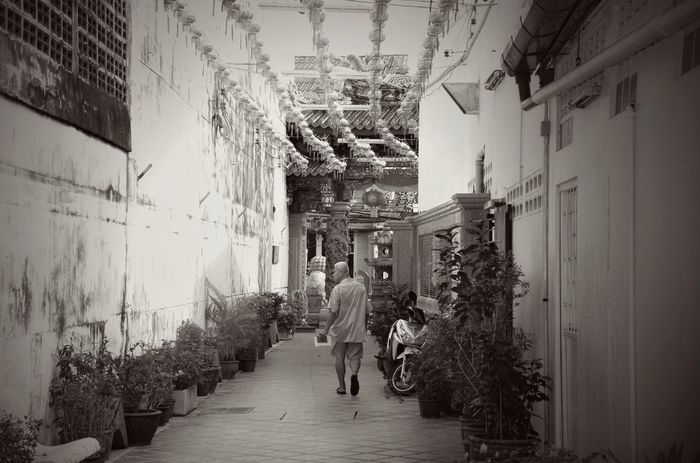 Adult Architecture Building Exterior Built Structure Day Full Length Looking Back Looking Back While Going Forward Men Monk  Outdoors People Phuket Old Town Real People Rear View Religion The Way Forward Walking