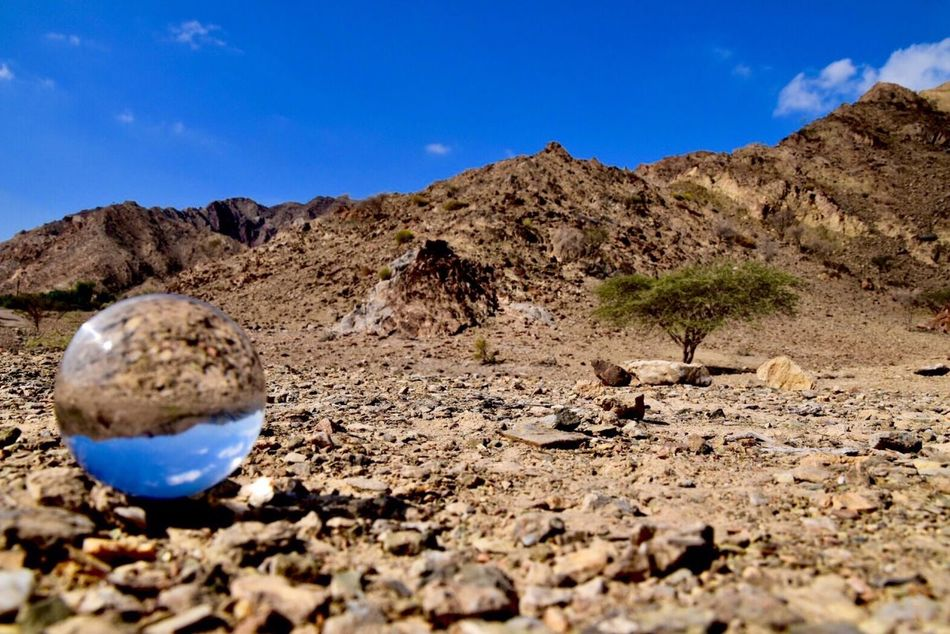 Adding perspective on Nature Glass Ball Photography Nikonphotography Nikon Blue Landscape Mountain Tranquil Scene Sky Physical Geography Rock - Object Tranquility No People Sand Clear Sky Beauty In Nature Outdoors Day Desert Nature Scenics