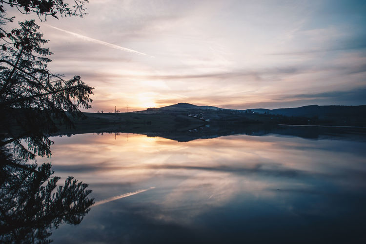 Beauty In Nature Cloud - Sky Idyllic Lake Mountain Nature No People Non-urban Scene Outdoors Plant Reflection Scenics - Nature Sky Sunset Tranquil Scene Tranquility Tree Water Waterfront