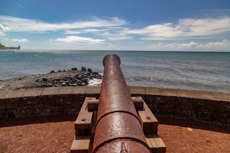 Old cannon at the waterfront of saint denis on reuinion island in the indian ocean