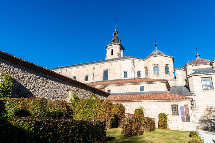 Monastery of El Paular in Madrid Church El Paular Architecture Built Structure Building Exterior Sky Building Blue Clear Sky Nature Place Of Worship Plant Religion History Day The Past Belief Low Angle View Spirituality Sunlight No People Outdoors Monastery Rascafría