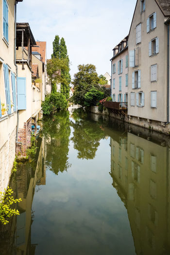 Architecture Blue Building Building Exterior Built Structure Canal City City Life Day Growth Nature No People Outdoors Reflection Residential Building Residential Structure Sky Standing Water Tranquility Tree Water
