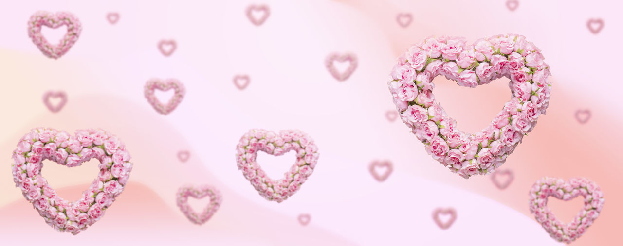 Directly above shot of heart shape on pink cake