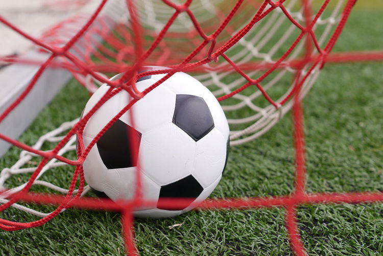 soccer Ball Close-up Day Field Focus On Foreground Football Grass Nature Net - Sports Equipment No People Outdoor Play Equipment Plant Red Soccer Soccer Ball Soccer Field Soccer Goal Sport Sports Equipment Team Sport White Color