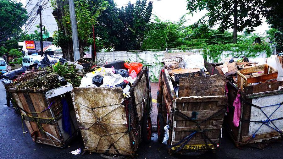 Garbage in row against plants