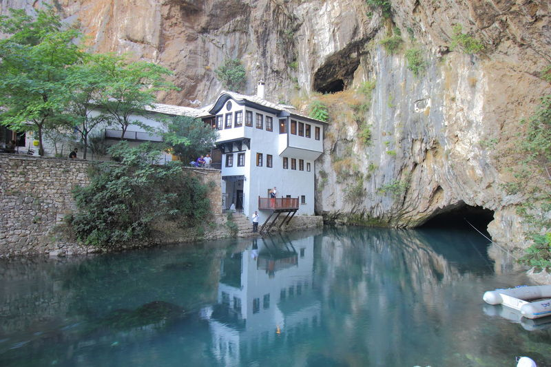 Tekke, the Islamic dervish or Sufi monastery stood spring that emerges from the cavern in Blagaj. Balkan Blagaj Bosnia And Herzegovina Travel Architecture Mountain Nature Reflection Scenics Sufism Tekke Tour Tourism Travel Destinations Water