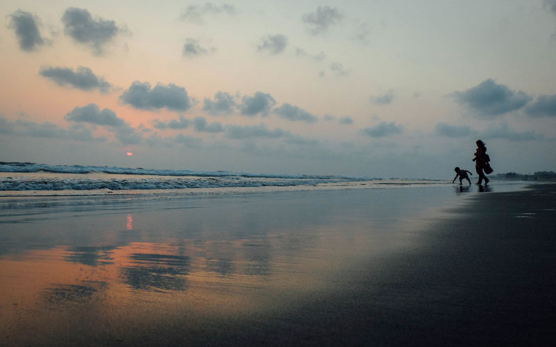 """Photo captured from the longest sea beach """"cox's bazar"""" of Bangladesh. Color Outdoors Nature Sky Water Sea Beach Cloud - Sky Two People Leisure Activity Tranquility Sunset Kid & Mom"""