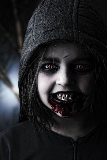 Portrait Of Vampire Girl With Artificial Blood On Mouth