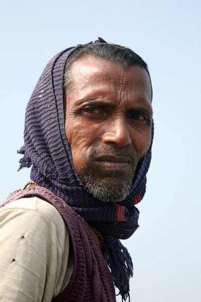 Portrait of a day laborer January 14, 2009 in Kumrokhali, West Bengal, India. Adult ASIA Face HEAD Headshot Hindu India Kumrokhali Laborer Look Looking At Camera Male Men Person Poor  Portrait Poverty Rural Street Village West Bengal Work Working