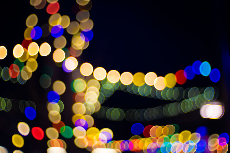 Lights blurred for background. Night party for your design concept Colorful Abstract Autumn Autumnal Background Blur Blurred Blurry Boke Bokeh Bright Celebration Christmas Circle Color Cosmic Decoration Defocus Defocused Design Disco Effect Fall Filter Glimmer Glitter Glittering Glittery Glitz Glow Glowing Gold Golden Halloween Holiday Light Magic Night Orange Sands Shimmer Shine Shiny Spark Sparkle Sparkly Texture Wallpaper White Yellow