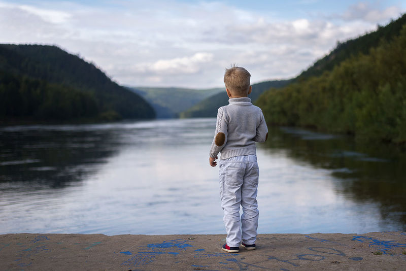 Full Length Child Lake One Person Childhood Nature Rear View Standing People Beach Outdoors Beauty In Nature Day