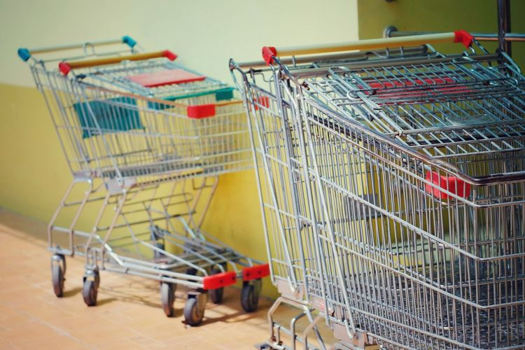 Close up shopping cart Shopping Cart Shopping Retail  Business Transportation Supermarket Store Equipment Empty Trolley Basket Sale Sell Buy Grocery Lifestyle Payment Credit Customer  Purchase Marketing Economic Economy Finance Budget
