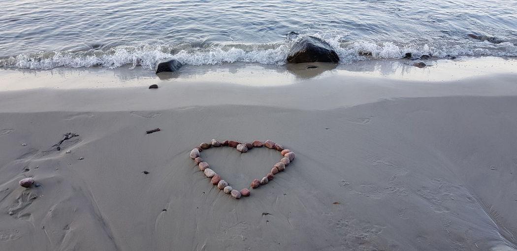 High angle view of heart shape on beach