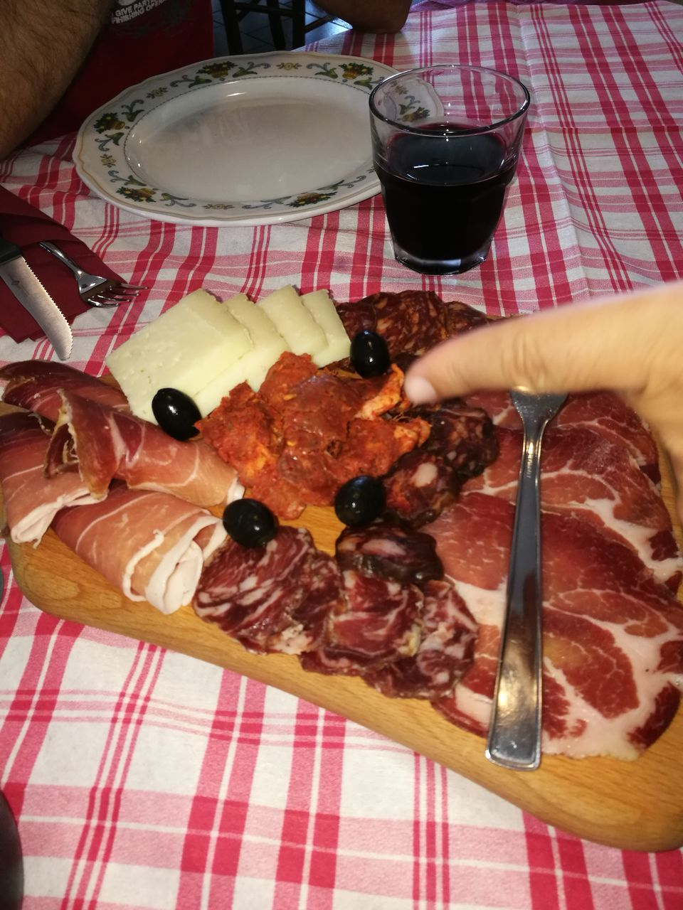 food and drink, human hand, food, human body part, real people, one person, indoors, red wine, indulgence, table, holding, tablecloth, plate, freshness, sweet food, ready-to-eat, temptation, dessert, meat, wineglass, lifestyles, unhealthy eating, close-up, day, people