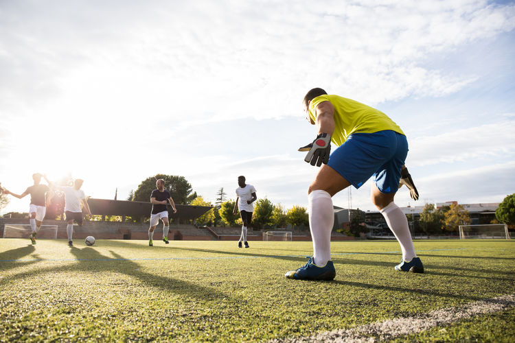 Male Athletes Playing Soccer On Field