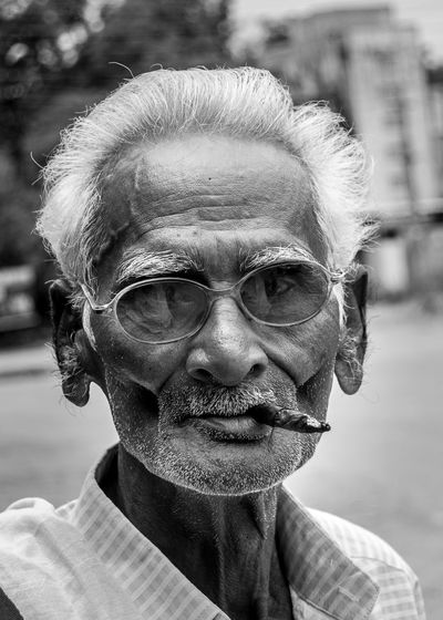 Cigars Gunbir Headshot Human Face Lifestyles Old Age Outdoors Portrait