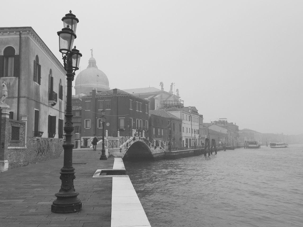 Santa Maria Della Salute By Grand Canal In Foggy Weather Against Sky