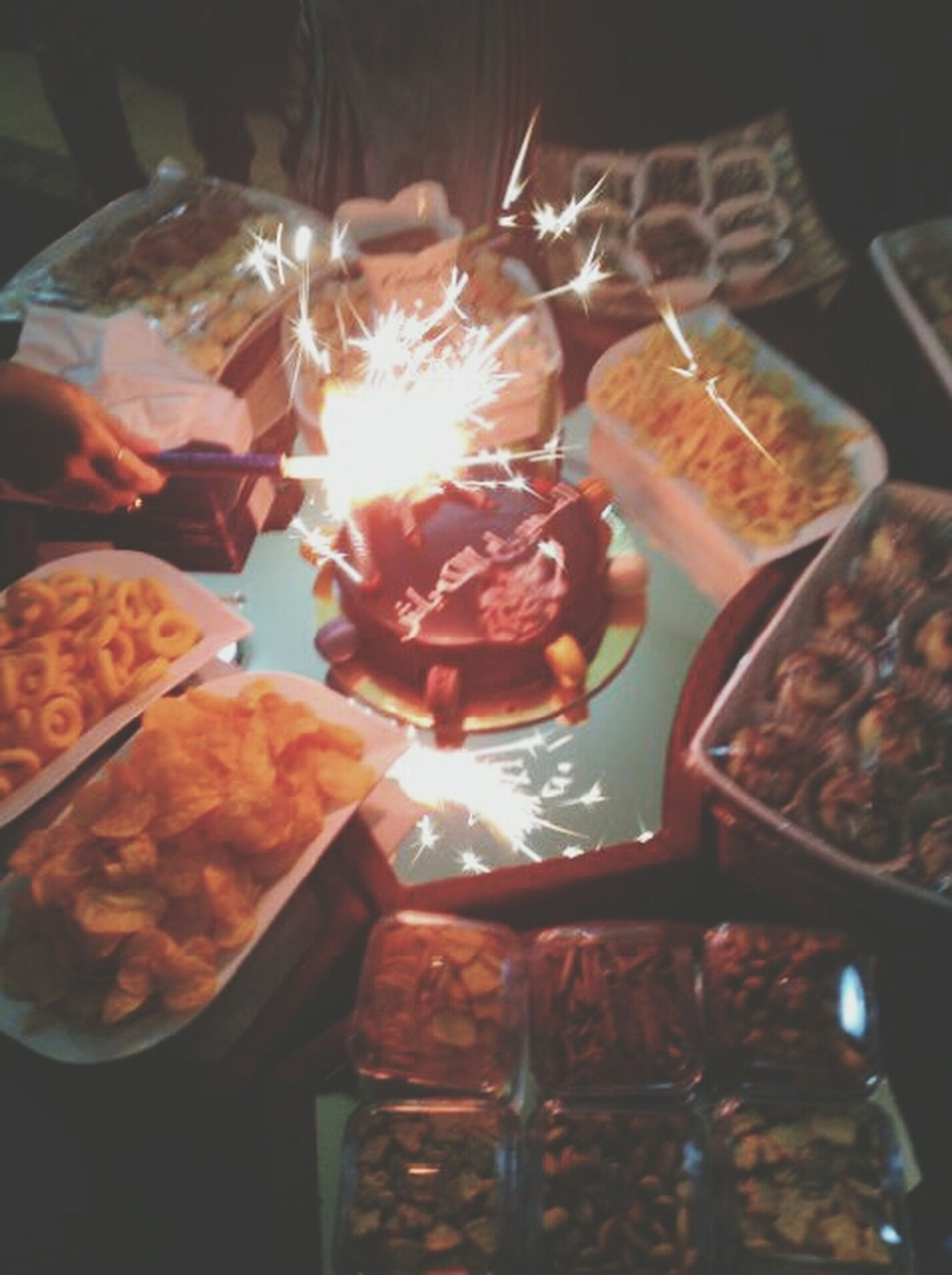 food and drink, food, indoors, freshness, sweet food, ready-to-eat, indulgence, unhealthy eating, close-up, dessert, flame, burning, heat - temperature, still life, table, temptation, one person, fire - natural phenomenon, person