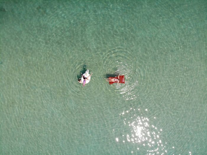 From Above  GREECE ♥♥ Red Air Mattress Day Directly Above Greece High Angle View Lake Leisure Activity Lifestyles Men Mode Of Transportation Nature Nautical Vessel Outdoors People Real People Rippled Transportation Turquoise Colored Two People Two People On The Beach Water Waterfront