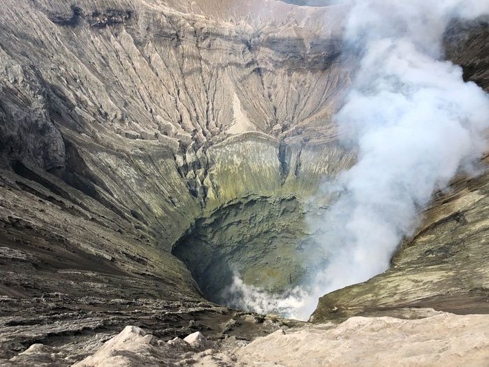 Travel Beauty In Nature Bromo Day Emitting Environment Formation Geology Land Landscape Mountain Nature No People Non-urban Scene Outdoors Physical Geography Power Power In Nature Rock Rock - Object Rock Formation Scenics - Nature Smoke - Physical Structure Solid Volcanic Crater