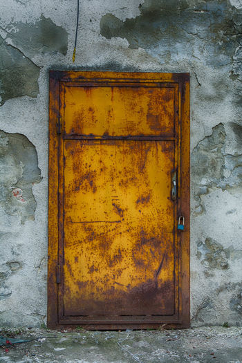 Architecture Door Built Structure Yellow Old Wall - Building Feature Closed Entrance No People Building Safety Building Exterior Weathered Security Protection Day Metal Wood - Material Wall House Outdoors Deterioration