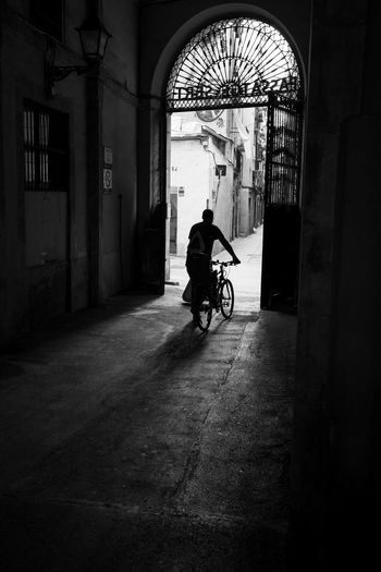 Indoors  Arch Bicycle One Man Only Window One Person Only Men Motorcycle Full Length People Day Architecture Adult Adults Only Street Xpro1 Streetphotography Real People Streetart Street Art Blackandwhite Street Photography Fujifilm Fuji Fujifilm_xseries