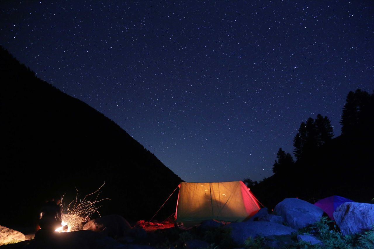 Tent on landscape at night