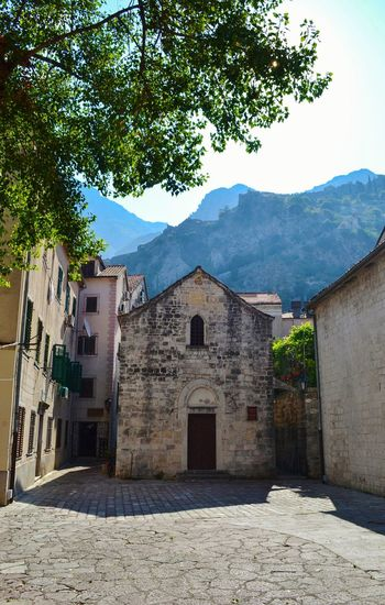 Little church Kotor Cattaro Montenegro Architecture Building Exterior Built Structure History Travel Destinations Tradition Tree Medieval Outdoors Mountains Square Home Church Miles Away The Secret Spaces