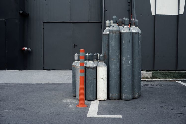 Gas Cylinders On Street Against Building
