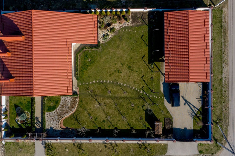 High angle view of houses and plants in field