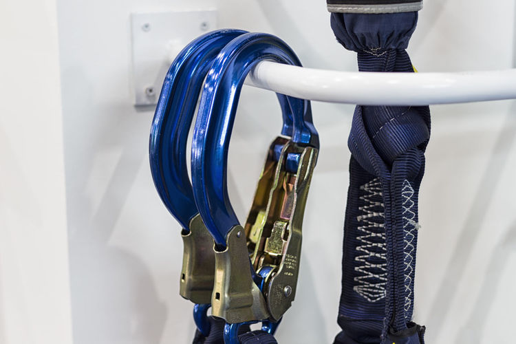 Blue Cable Carabiners Close-up Connection Day Domestic Room Electrical Equipment Equipment Focus On Foreground Handle Indoors  Industry Machine Part Machinery Metal No People Standing Still Life Technology Wall - Building Feature White Color