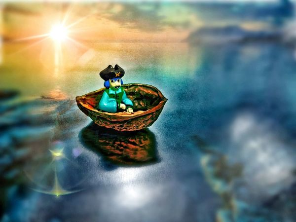Naif artistic composition,with pirate aboard half a walnut. Naif ArtWork Art, Drawing, Creativity Creative Photography Imagine Pirates Walnut Boat Lifeboat Pirate Showcase: December Eye4enchanting Dreaming Treasures CastAway  Children_collection Fantasy Edits Sea And Sky Sunset_collection Freelance Life Relaxing Toy Warm Colors