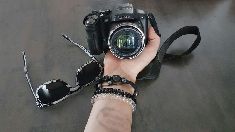 Insignia of the night... Stamp Sunglasses Camera - Photographic Equipment Skin Morning After Bracelet Shamballa Wooden Texture Lense Hawkers Body Part Hand A Bird's Eye View Lieblingsteil