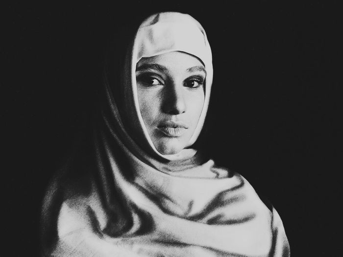 She Headshot Portrait One Person Looking At Camera Front View Indoors  Headscarf Young Adult Black Background Hijab Studio Shot Women Lifestyles Real People Young Women Leisure Activity Casual Clothing Adult Contemplation Human Face Beautiful Woman