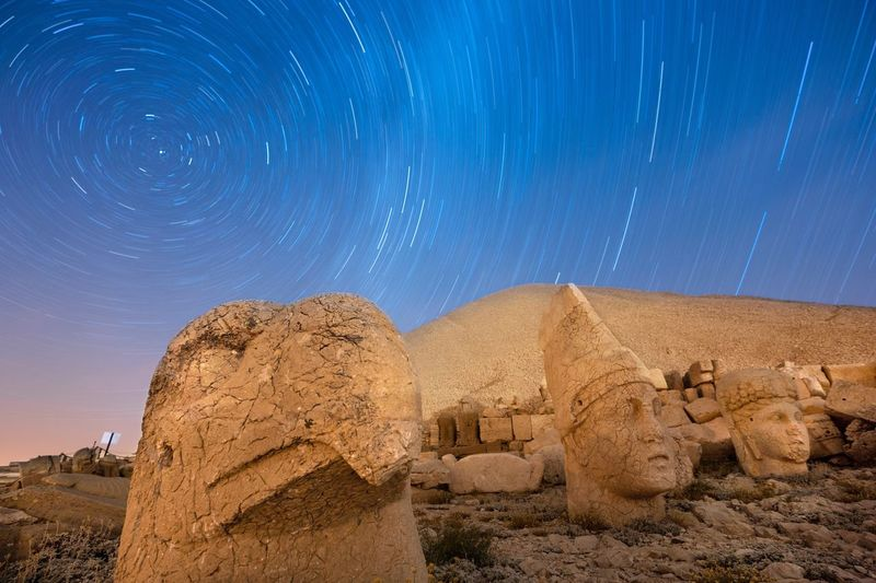 Panoramic view of rock formation against sky at night