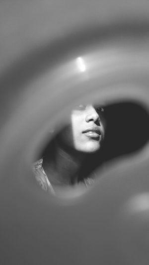 Woman Seen Through Hole