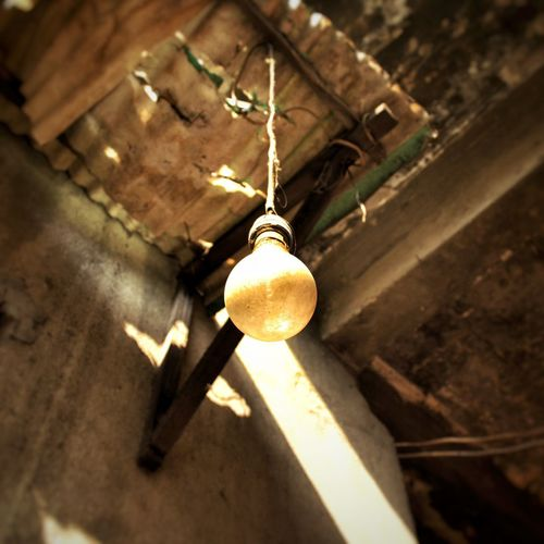 fireflyHanging No People Low Angle View Illuminated Outdoors Day Close-up Light Lamp Past Old House Worn Yellowing
