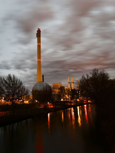 Power plant at night Sky Cloud - Sky Building Exterior Built Structure Architecture Factory Water Reflection Industry Nature No People Tower Tree Waterfront Outdoors Illuminated Environmental Issues Pollution Air Pollution Cooling Tower Energy Night Lights Nightphotography Power Plant At Night Power Plant Cogeneration Plant Heizkraftwerk  Thermal Power Station Heating And Power Station