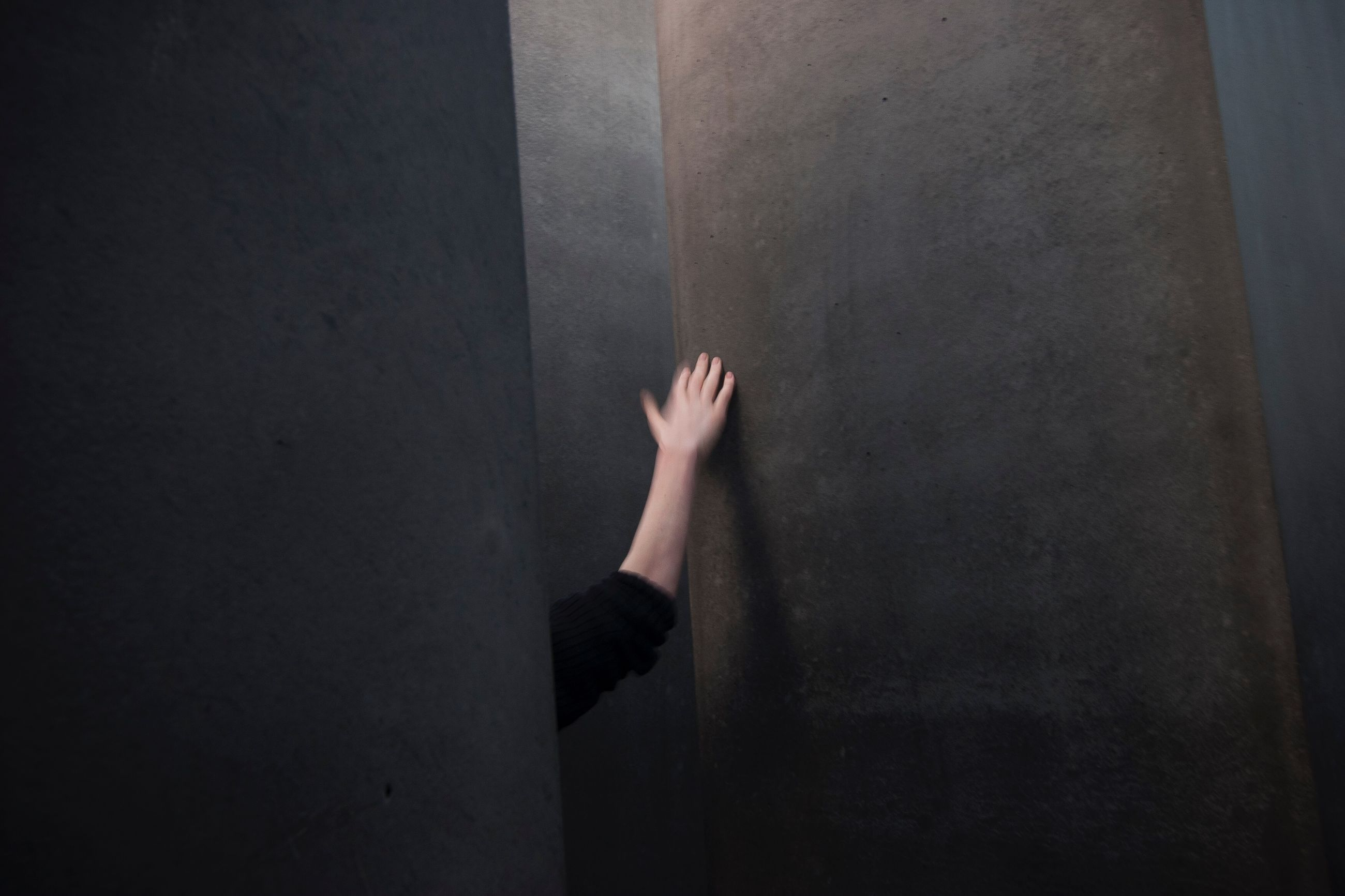 human body part, one person, body part, human hand, hand, indoors, real people, wall - building feature, unrecognizable person, leisure activity, day, lifestyles, architecture, dark, adult, limb, women, barefoot, human limb, contemplation