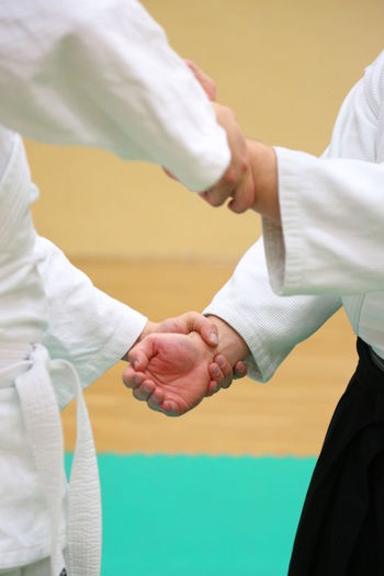 Man with trainer practicing aikido